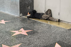 Hollywood Walk of Fame homeless man on the street, sidewalk Royalty Free Stock Photo