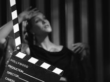 Hollywood woman and clapboard Stock Images
