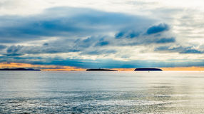 Holm Islands at Sunset during typical British Autumn Weather. Steep Holm and Flat Holm Islands in the Bristol Channel at sunset during typical British autumn Royalty Free Stock Photos