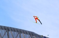 Holmenkollen ski jump. The Holmenkollen ski jump in Oslo, Norway, with a jumper in flight. The 2011 FIS Nordic World Ski Championships will take place in Oslo Royalty Free Stock Photos