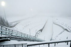 Holmenkollen ski jump in fogg, Oslo, Norway Stock Photography