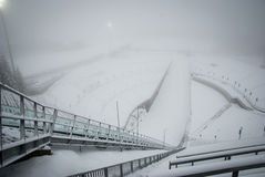 Holmenkollen ski jump in fogg, Oslo, Norway Royalty Free Stock Photography
