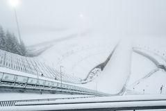 Holmenkollen ski jump in fogg, Oslo, Norway Royalty Free Stock Image
