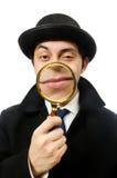 Holmes di Sherlock con la lente d'ingrandimento Immagini Stock