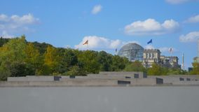 Holocaust Memorial in the background of the Reichstag.