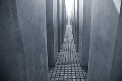 Holocaust Memorial Berlin. The Holocaost Memorial - Berlin, Germany opened 2005. The monument consist of 2711 concrete blocks placed on 19.000 squaremeters Royalty Free Stock Image