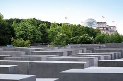 Holocaust memorial in Berlin. Memorial to the Murdered Jews of Europe, the Holocaust memorial in Berlin with Reichstag dome on the background.The memorial was on Royalty Free Stock Photography
