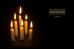 Holocaust Remembrance Day, January 27, candles against black bac. Six burning candles against black background, text International Holocaust Remembrance Day Royalty Free Stock Images