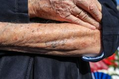 Holocaust survivor Heinz Kounio shows his tattooed serial number Royalty Free Stock Photography