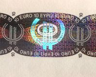 Hologram. Protection on a 10 euro banknote royalty free stock photo