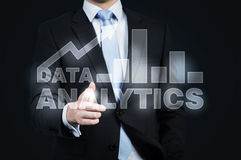 A hologram of data analytics and a businessman offering handshake. Royalty Free Stock Photos