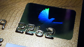 posibilities of financial chance, Hologram Dove credit card Stock Photos