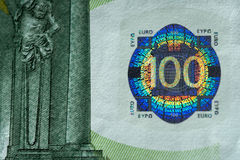 Hologram on a one hundred euros banknote. Royalty Free Stock Photography