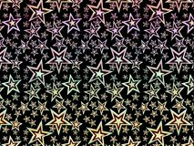 A hologram paper made of stars and different colors for backgrounds, packaging, or wallpapers.  Stock Photos