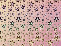 A hologram paper made of stars and different colors for backgrounds, packaging, or wallpapers.  Stock Image