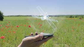 Hologram of satellite on a smartphone. Person activates holographic image on the phone screen on the field with blooming poppies stock footage