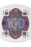 One hundred euro note hologram. Hologram sticker to protect against counterfeiting and counterfeiters Royalty Free Stock Image