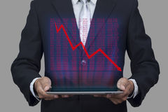 Hologram of stock market price display chart pop up from tablet. Business concept Royalty Free Stock Image
