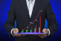 Hologram of success graph display chart pop up from tablet. On Blue screen Royalty Free Stock Image