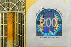 Hologram on a two hundred euros banknote. Stock Photos