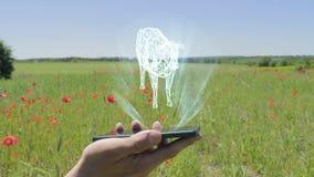 Hologram van koe op een smartphone stock video