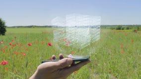 Holograma de pilas de dinero en un smartphone almacen de video