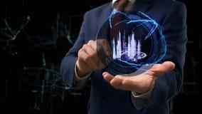 Hologrammet 3d för affärsmanshowbegreppet ilar staden på hans hand stock video