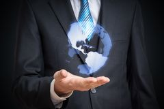 Holographic projection of Earth above mans hand Stock Photos