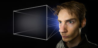 Holographic Universe. Image illustrating the holographic universe theory of reality, with a man projecting his mental screen, giving him the illusion of Stock Photos