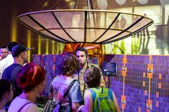 Army instructor tells visitors about the principle of the satellite dish at the army exhibition `Our IDF` stock photo