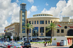 Holon shopping mall. Holon, Israel-July 21, 2016:  Holon shopping mall, outdoor view of semi-round main entrance with tall tower clock. There are cars waiting Stock Photo