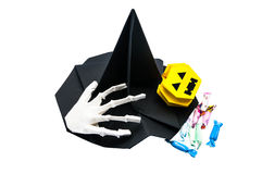 Holoween accessory. Witch hat ,paper bone hand ,Pumpkin and candy Royalty Free Stock Photos