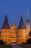 Holstein gate and Petri church by night in Lubeck Stock Photos