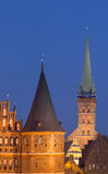 Holstein gate and Petri church by night in Lubeck Royalty Free Stock Photos