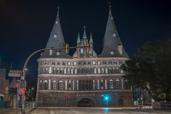 Holstentor in Luebeck at night Stock Images