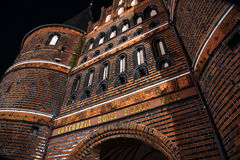 Holstentor in Luebeck at night, detail of the medieval city gate Stock Images