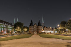 Holstentor in Luebeck at night with stars Stock Photos