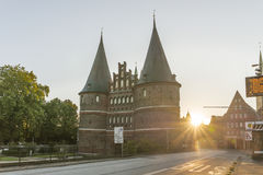 Holstentor in Luebeck during sunrise Stock Images