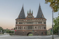Holstentor in Luebeck during sunrise with moon Stock Photo