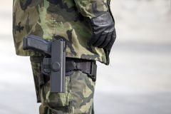 Holster with a gun on the leg. Of the military stock image
