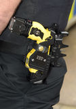 Holstered Police Taser gun. Taser X26 ECD (Electronic Control Device) as used by law enforcement officers and armed forces. Taser is classed as a handgun in many stock image
