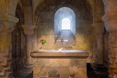 The holy altarpiece in Lund cathedral. Sandstone altar in the crypt of Lund cathedral. Consecrated 1123 Stock Photos