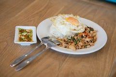Holy Basil fried rice, pork and fried egg. Basil fried rice, pork and fried egg Royalty Free Stock Image