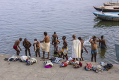 The holy bath in the Ganges. A group of men is taking a holy bath in the river Ganges Royalty Free Stock Images
