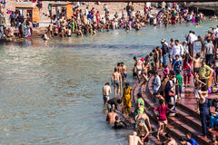 Holy bath in the Ganges. Hindus are taking the holy bath in the waters of the Ganges at Haridwar, India royalty free stock image