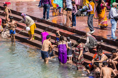 Holy bath in the Ganges. Hindus are taking the holy bath in the waters of the Ganges at Haridwar, India stock image
