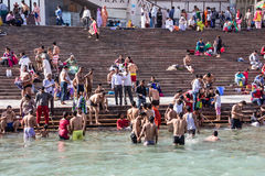 Holy bath in the Ganges. Hindus are taking the holy bath in the waters of the Ganges at Haridwar, India royalty free stock photo