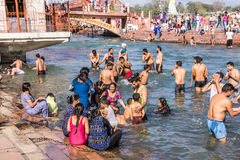 Holy bath in the Ganges. Hindus are taking the holy bath in the waters of the Ganges at Haridwar, India royalty free stock images