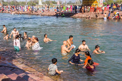 Holy bath in the Ganges. Hindus are taking the holy bath in the waters of the Ganges at Haridwar, India royalty free stock photos