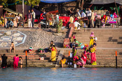 Holy bath in the Ganges. Hindus are taking the holy bath in the waters of the Ganges at Haridwar, India royalty free stock photography
